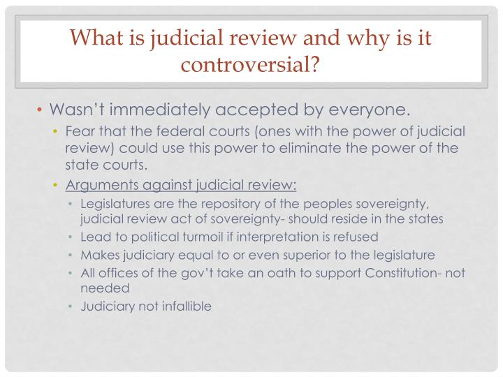 What is judicial review and why is it controversial?