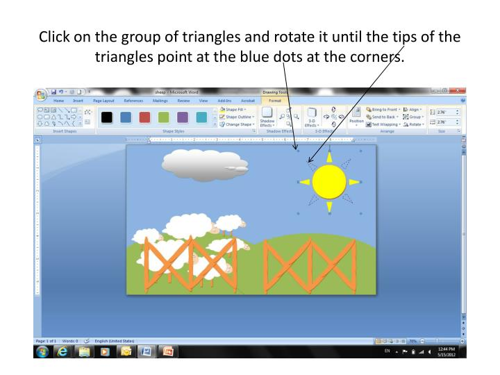 Click on the group of triangles and rotate it until the tips of the triangles point at the blue dots at the corners.