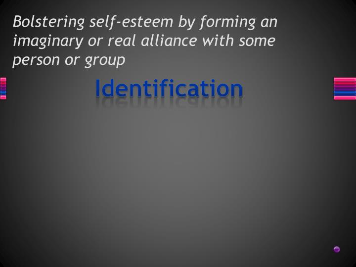 Bolstering self esteem by forming an imaginary or real alliance with some person or group