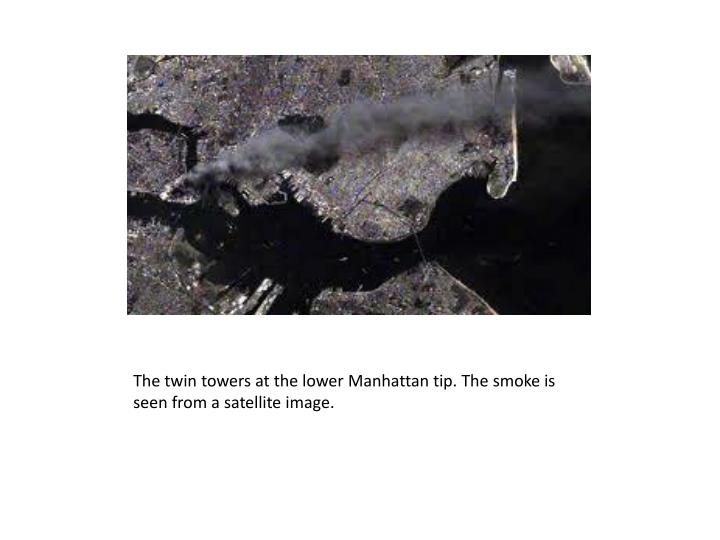 The twin towers at the lower Manhattan tip. The smoke is seen from a satellite image.