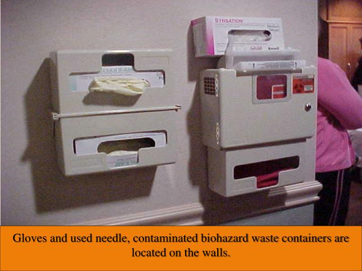 Gloves and used needle, contaminated biohazard waste containers are located on the walls.