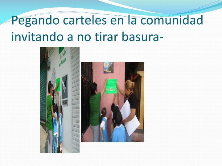 Pegando carteles en la comunidad  invitando a no tirar basura-