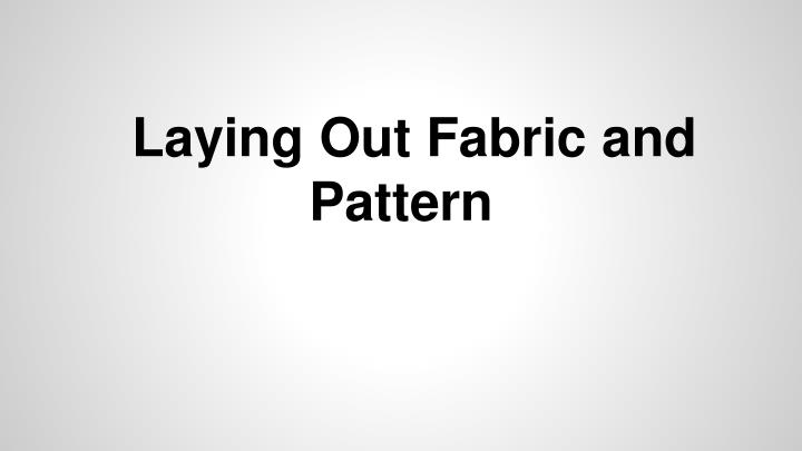 Laying out fabric and pattern