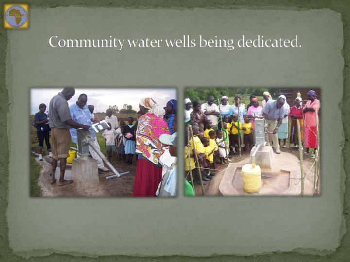 Community water wells being dedicated.