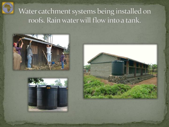 Water catchment systems being installed on roofs. Rain water will flow into a tank.