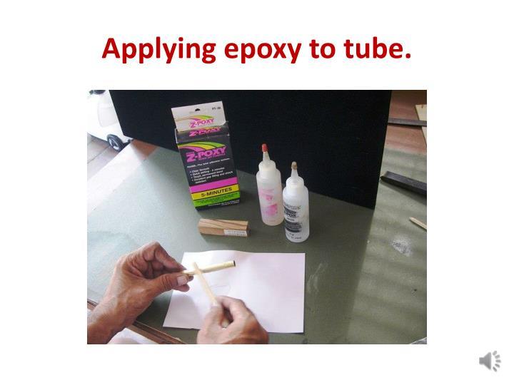 Applying epoxy to tube.