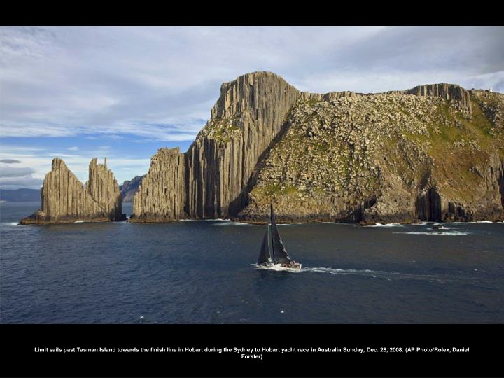 Limit sails past Tasman Island towards the finish line in Hobart during the Sydney to Hobart yacht race in Australia Sunday, Dec. 28, 2008. (AP Photo/Rolex, Daniel Forster)