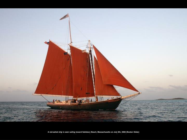 A red-sailed ship is seen sailing toward Salisbury Beach, Massachusetts on July 9th, 2008 (Boston Globe)