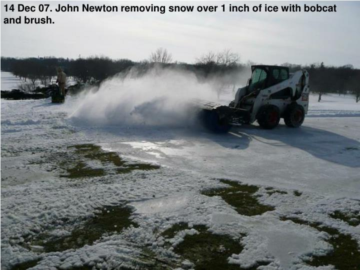14 Dec 07. John Newton removing snow over 1 inch of ice with bobcat and brush.