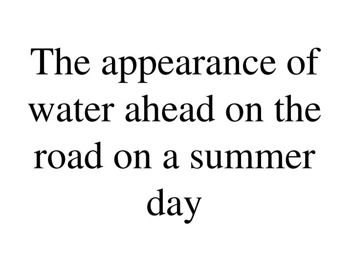The appearance of water ahead on the road on a summer day