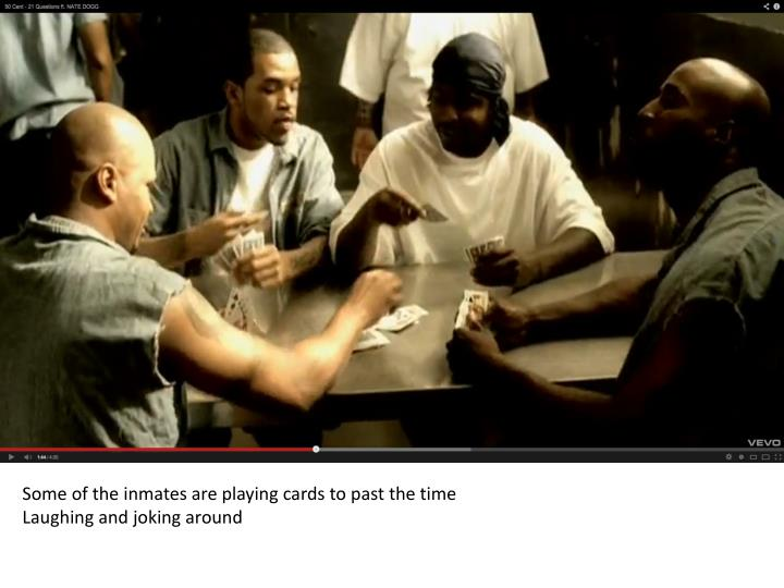 Some of the inmates are playing cards to past the time