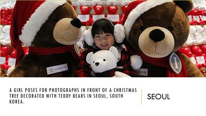 A girl poses for photographs in front of a Christmas tree decorated with teddy bears in Seoul, South Korea.