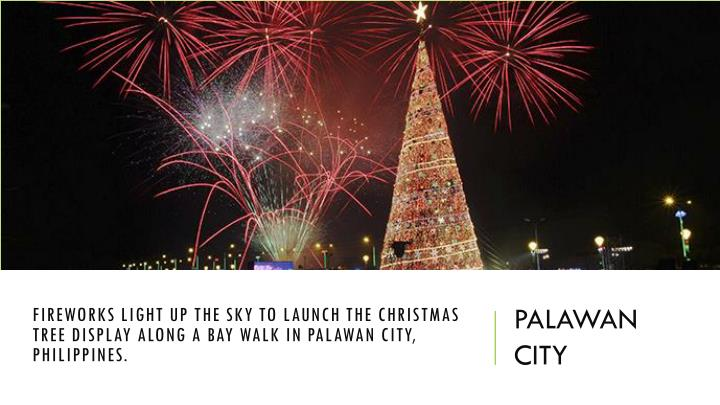 Fireworks light up the sky to launch the Christmas tree display along a bay walk in Palawan city, Philippines.