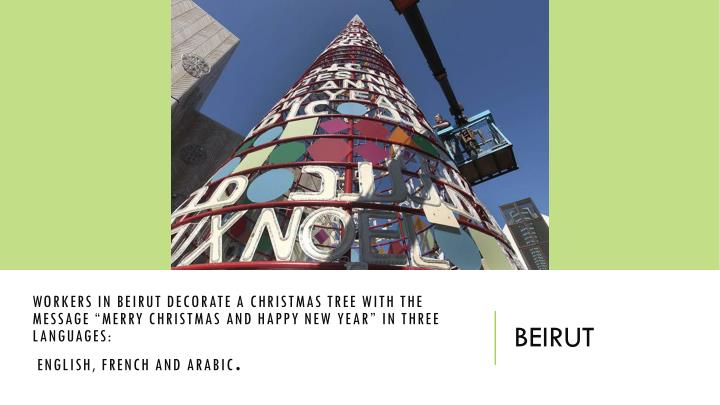 Workers in Beirut decorate a Christmas tree with the