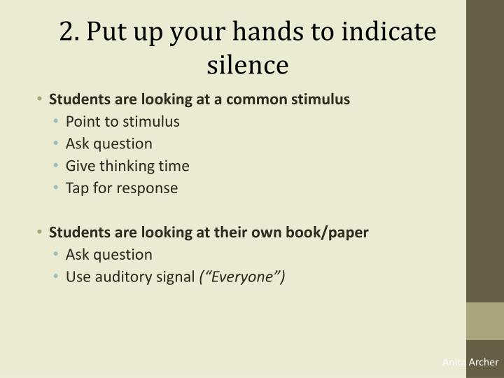 2. Put up your hands to indicate silence