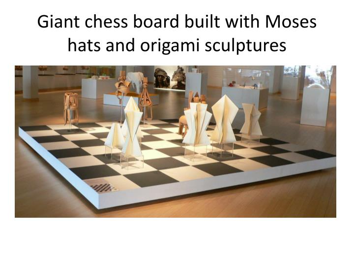 Giant chess board built with Moses hats and origami sculptures