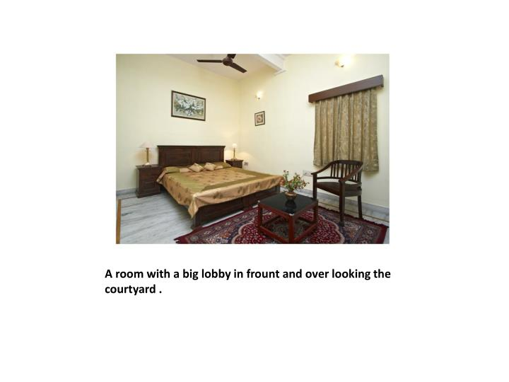 A room with a big lobby in frount and over looking the courtyard .