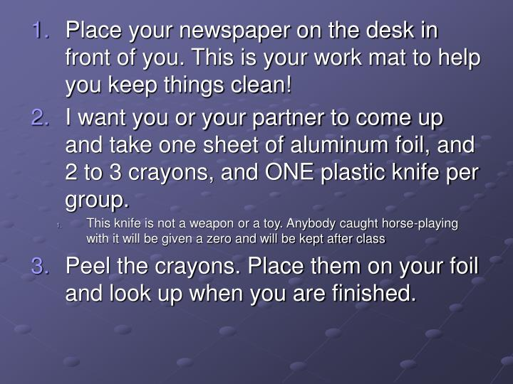 Place your newspaper on the desk in front of you. This is your work mat to help you keep things clean!