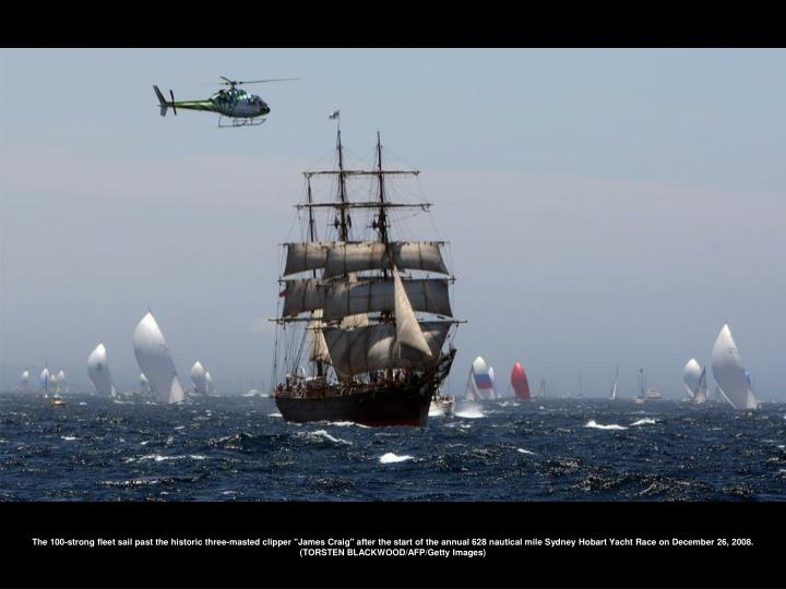 """The 100-strong fleet sail past the historic three-masted clipper """"James Craig"""" after the start of the annual 628 nautical mile Sydney Hobart Yacht Race on December 26, 2008. (TORSTEN BLACKWOOD/AFP/Getty Images)"""