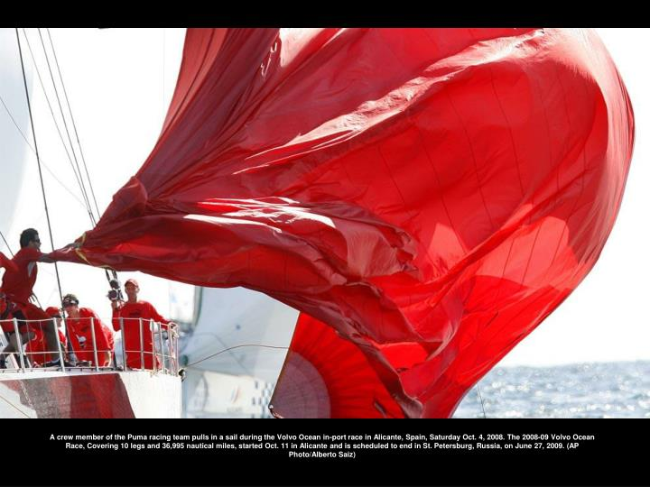 A crew member of the Puma racing team pulls in a sail during the Volvo Ocean in-port race in Alicante, Spain, Saturday Oct. 4, 2008. The 2008-09 Volvo Ocean Race, Covering 10 legs and 36,995 nautical miles, started Oct. 11 in Alicante and is scheduled to end in St. Petersburg, Russia, on June 27, 2009. (AP Photo/Alberto Saiz)