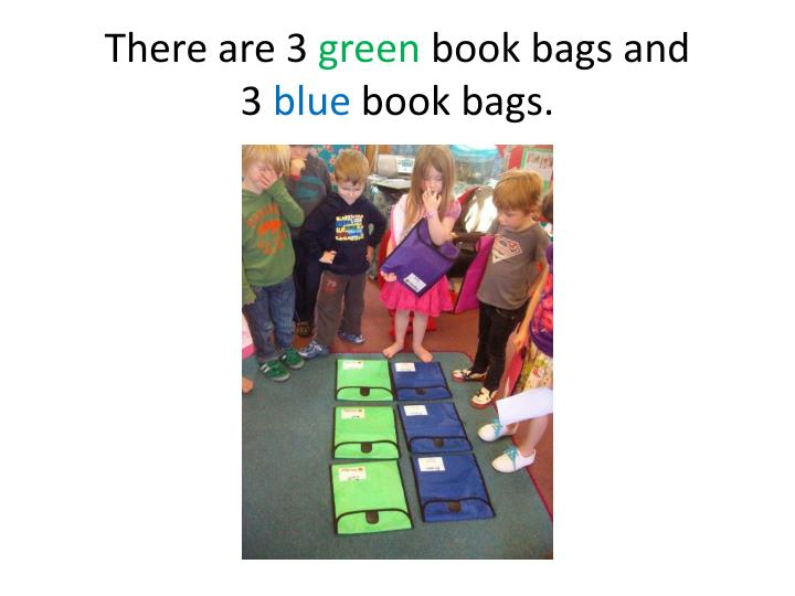 There are 3 green book bags and 3 blue book bags