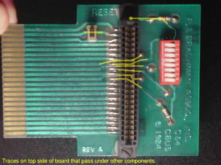 Traces on top side of board that pass under other components.