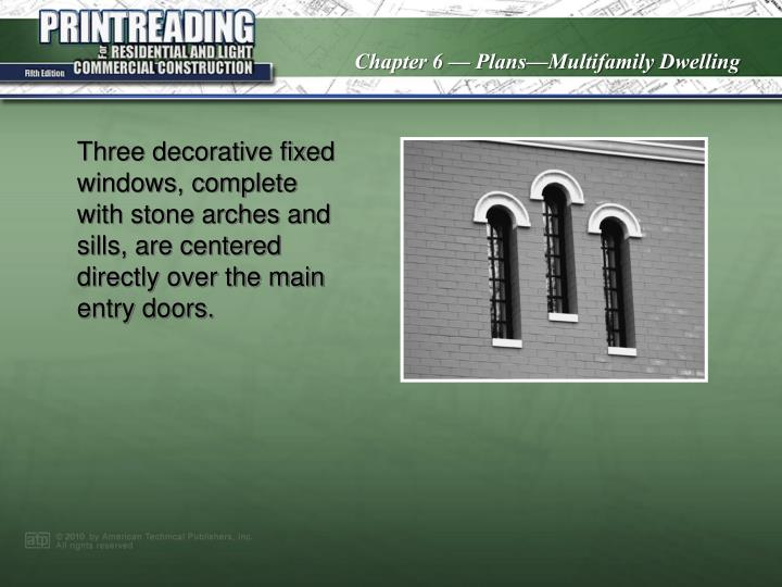 Three decorative fixed windows, complete with stone arches and sills, are centered directly over the main entry doors.