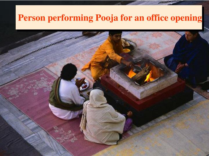 Person performing Pooja for an office opening