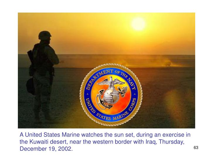 A United States Marine watches the sun set, during an exercise in the Kuwaiti desert, near the western border with Iraq, Thursday, December 19, 2002.
