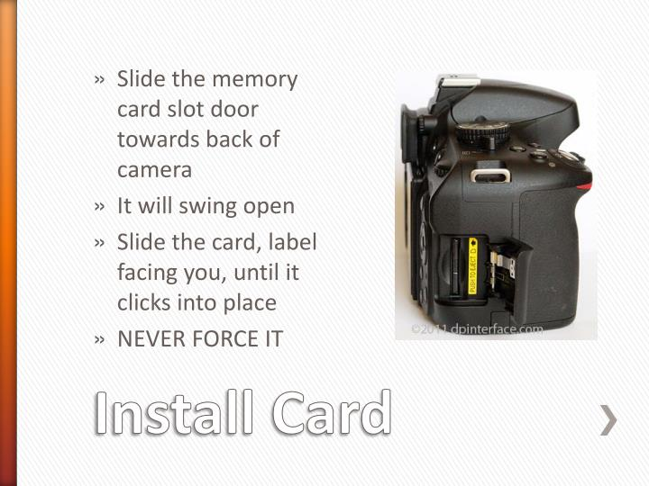 Slide the memory card slot door towards back of camera