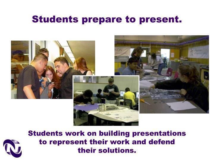 Students prepare to present.