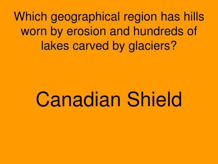 Which geographical region has hills worn by erosion and hundreds of lakes carved by glaciers?