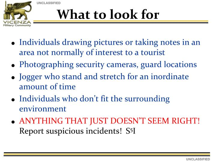 Individuals drawing pictures or taking notes in an area not normally of interest to a tourist