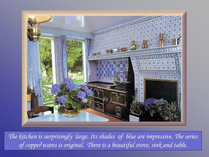 The kitchen is surprisingly  large. Its shades  of  blue are impressive. The series of copper