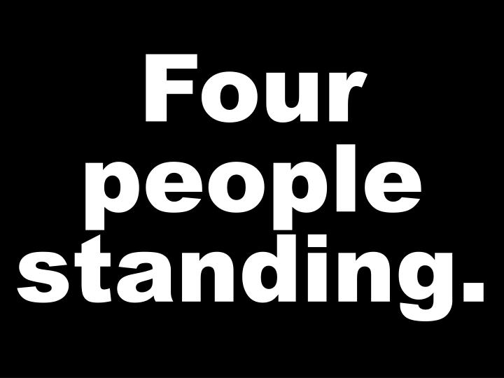 Four people standing.