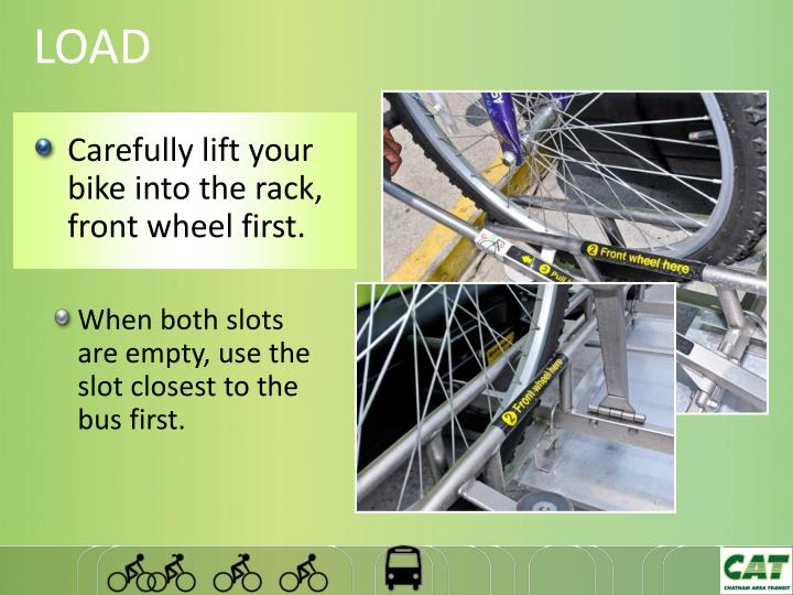 Carefully lift your bike into the rack, front wheel first.