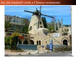 an old windmill with a chinese restaurant