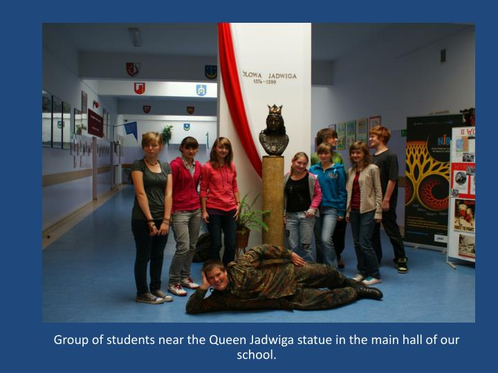 Group of students near the Queen Jadwiga statue in the main hall of our school.