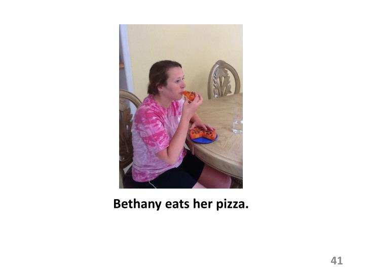 Bethany eats her pizza.