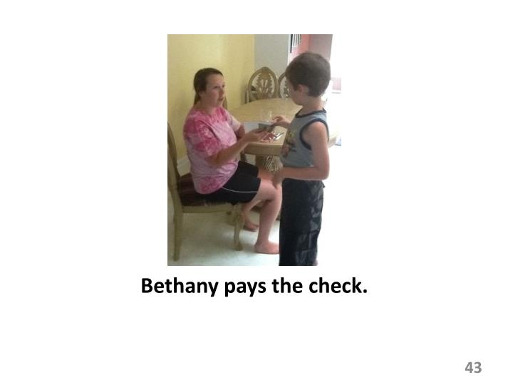 Bethany pays the check.