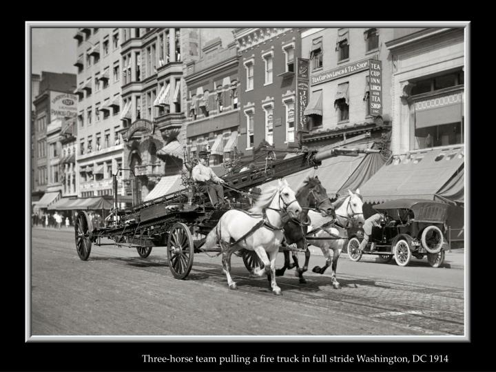 Three-horse team pulling a fire truck in full stride Washington, DC 1914