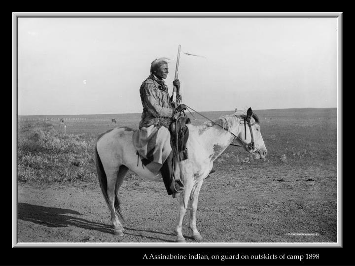 A Assinaboine indian, on guard on outskirts of camp 1898