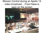 mission control during an apollo 13 video broadcast fred haise is seen on the screen