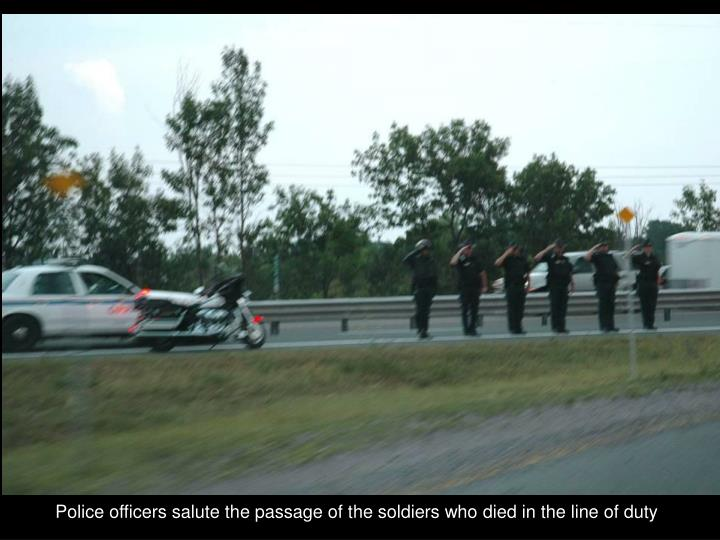 Police officers salute the passage of the soldiers who died in the line of duty