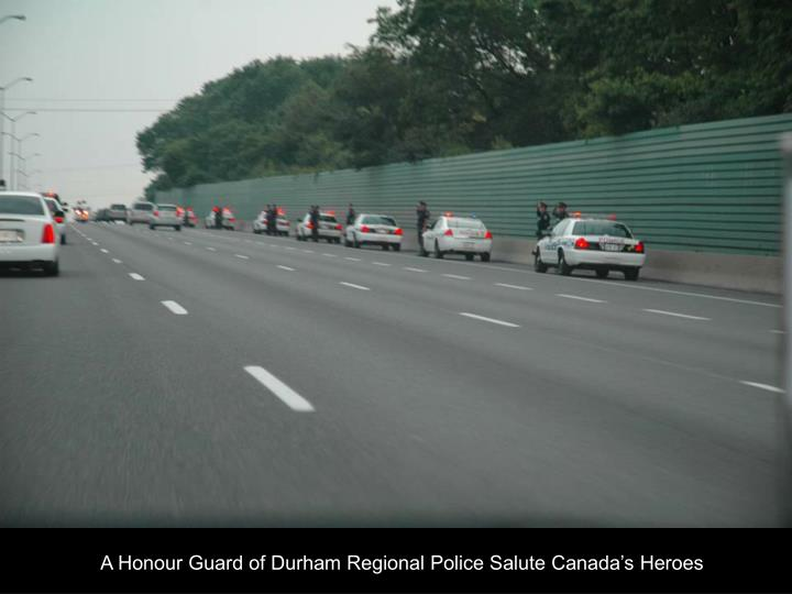 A Honour Guard of Durham Regional Police Salute Canada's Heroes