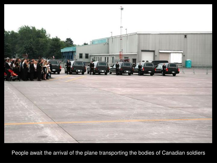 People await the arrival of the plane transporting the bodies of Canadian soldiers