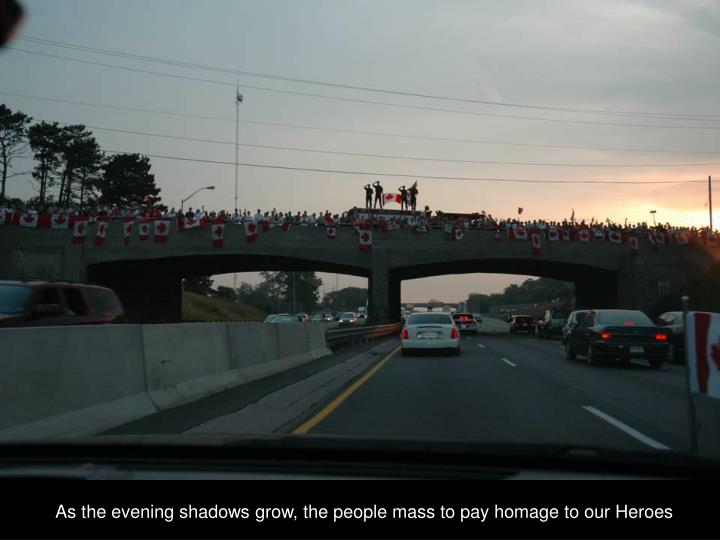 As the evening shadows grow, the people mass to pay homage to our Heroes