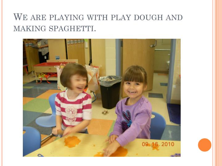 We are playing with play dough and making spaghetti.