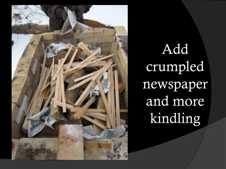 Add crumpled newspaper and more kindling