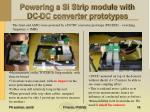 powering a si strip module with dc dc converter prototypes